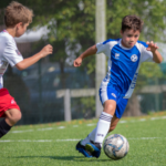 WHAT ARE THE BENEFITS OF PLAYING TEAM SPORT WHEN YOU'RE YOUNG?