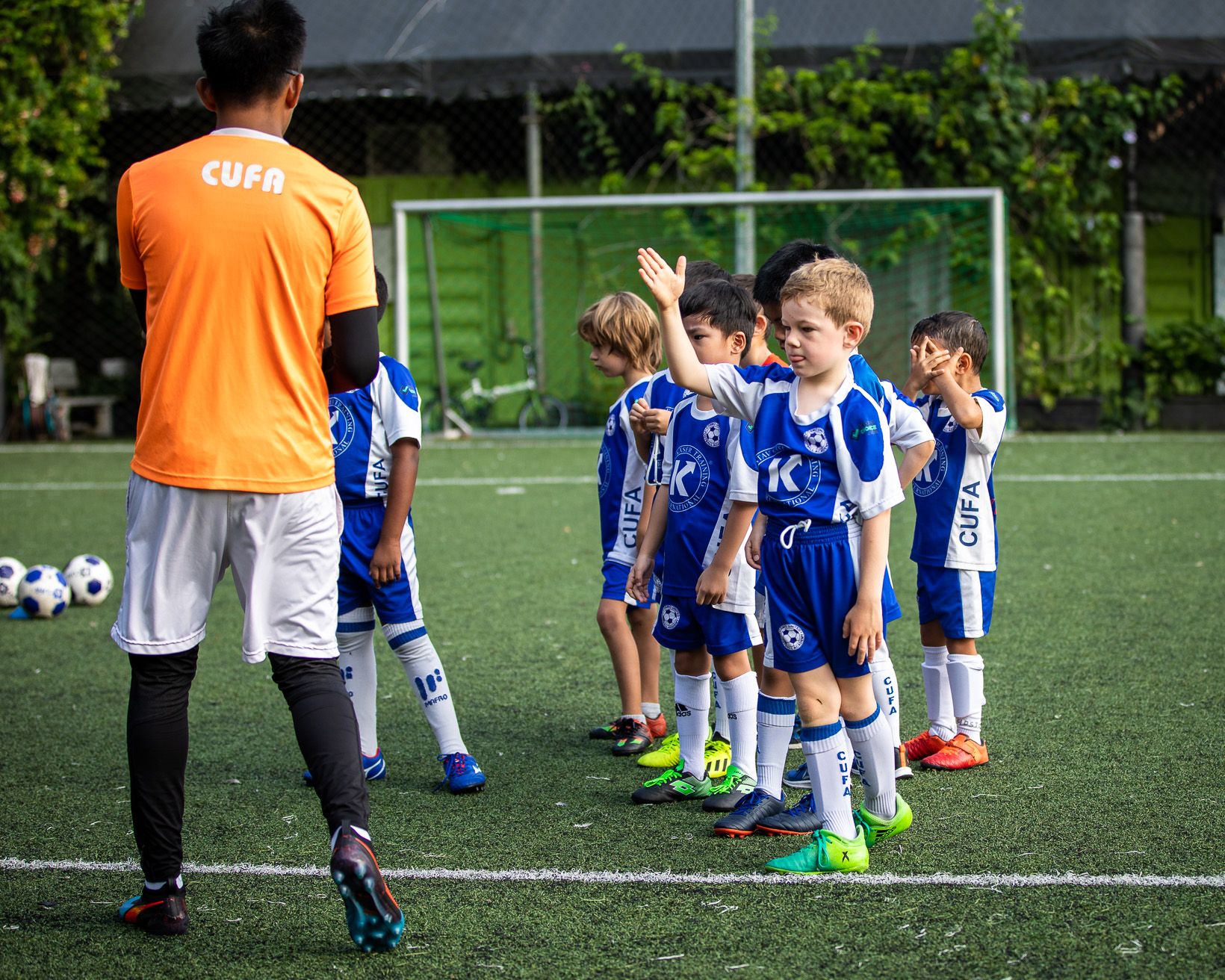 Children playing football at a holiday football camp