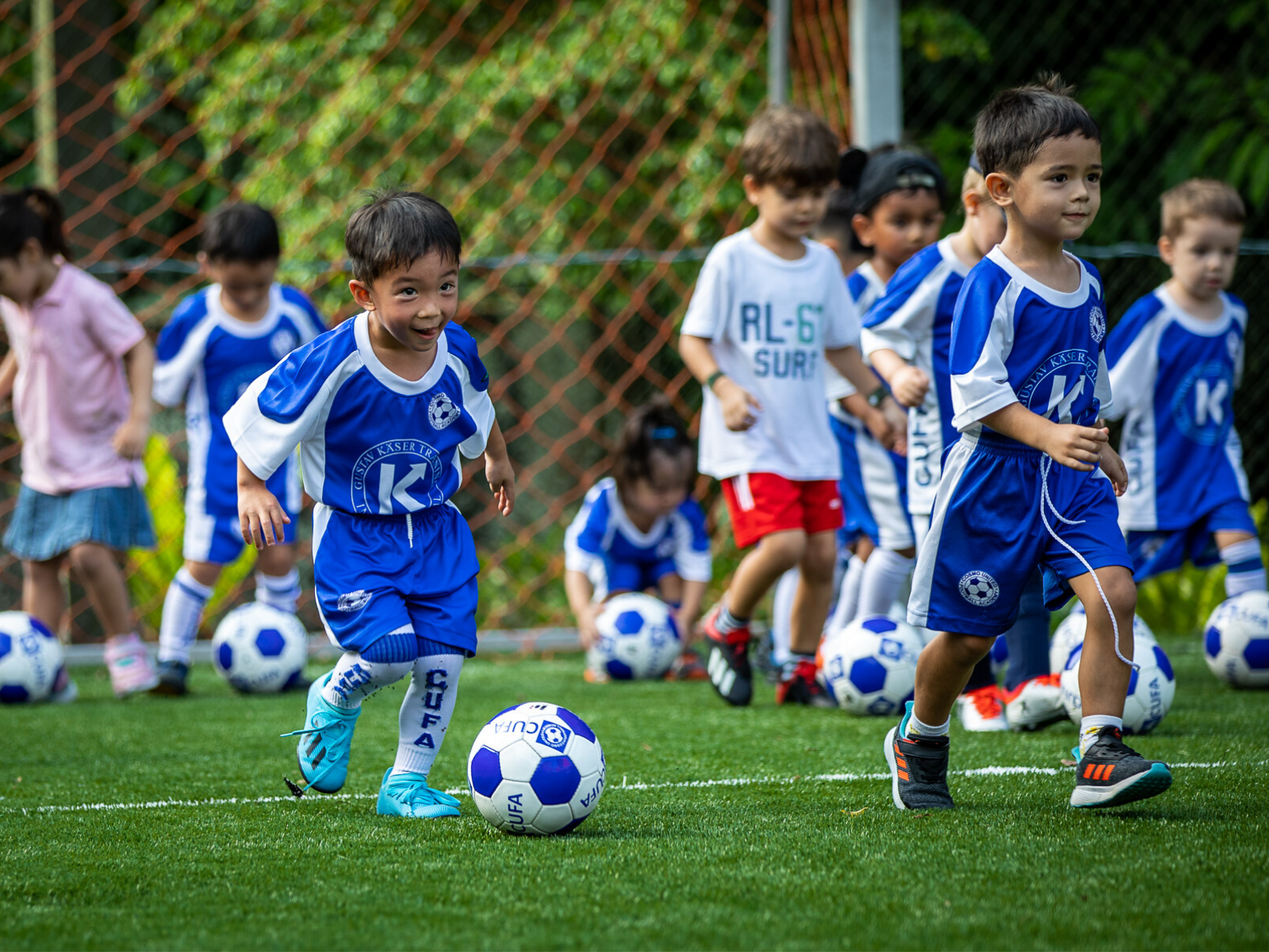 Holiday camp for kids playing football